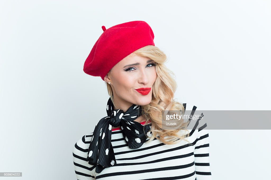 723d49fefbb48 Sensual blonde french woman wearing red beret