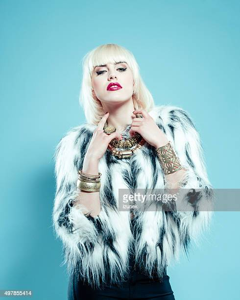sensual blonde woman wearing fur jacket and gold jewlery - diva human role stock photos and pictures