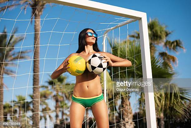sensual brazilian woman with soccer ball - legs spread woman stock photos and pictures