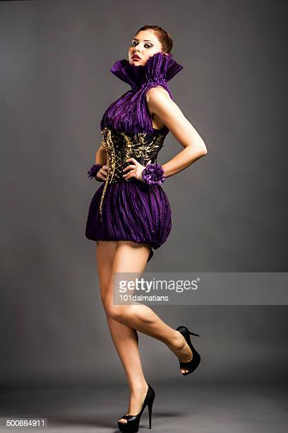 sensual fashion model - purple dress stock pictures, royalty-free photos & images