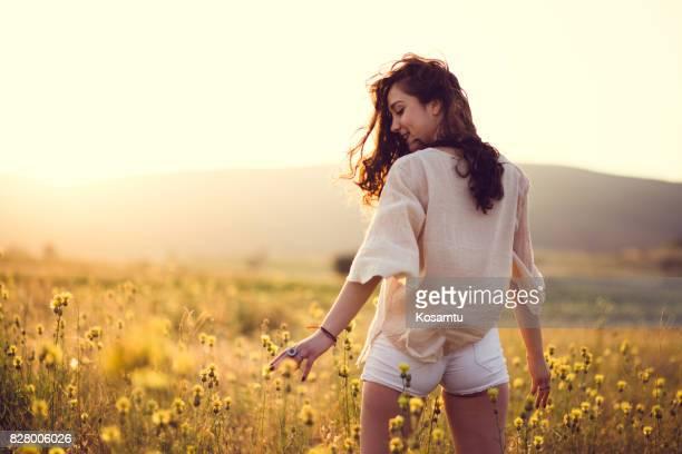 Sensual Girl In Yellow Field