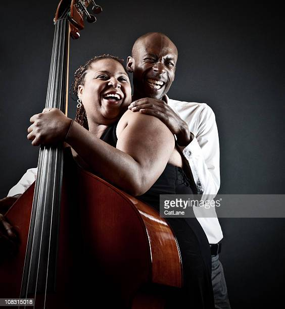 sensual jazz duet - violin family stock photos and pictures