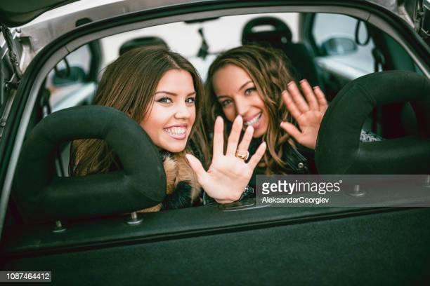 Sensual Ladies On Backseat Shaking Hands Before Leaving