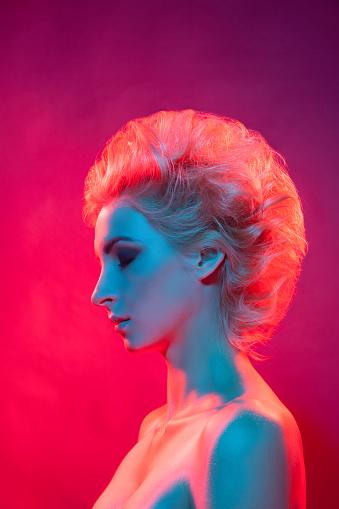 Sensual model standing in mysterious studio light - gettyimageskorea