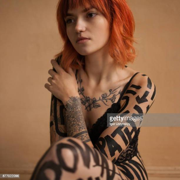 Sensual photography of red-haired woman