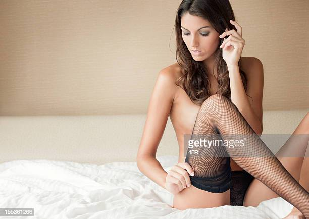 sensual seduction (xxxl) - dressed undressed women stockfoto's en -beelden