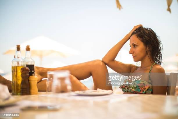 Sensual Woman in Bikini Waiting For Lunch