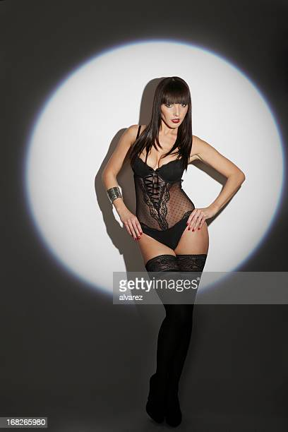 sensual woman in lingerie - women wearing garter belts stock photos and pictures