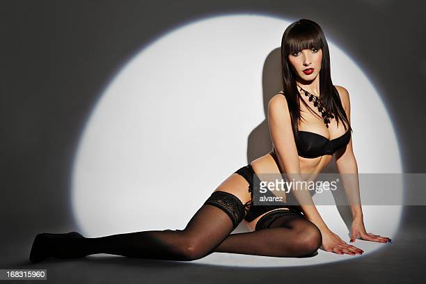 sensual woman in lingerie - suspenders stock pictures, royalty-free photos & images