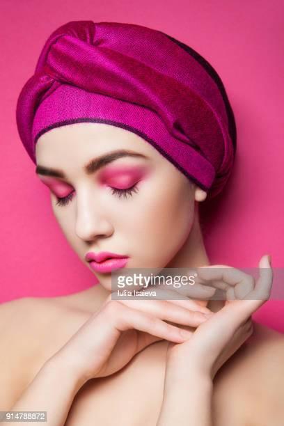 Sensual woman in pink turban