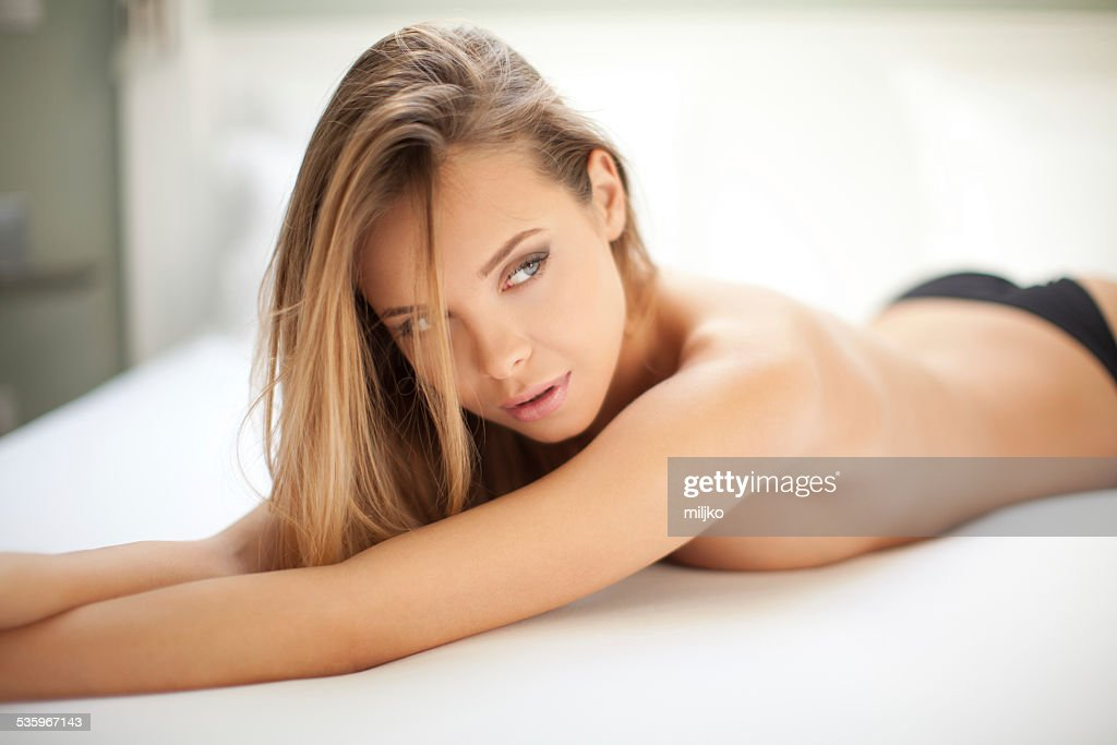 Sensual woman in the bedroom : Stock Photo