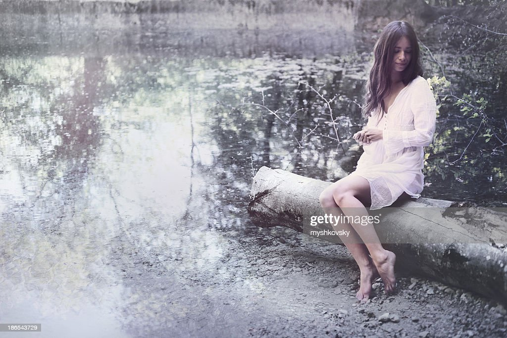 Sensual woman on the lake. : Stock Photo