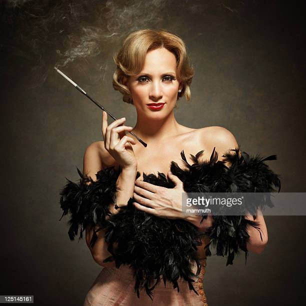sensual woman smoking - vintage style - diva human role stock photos and pictures