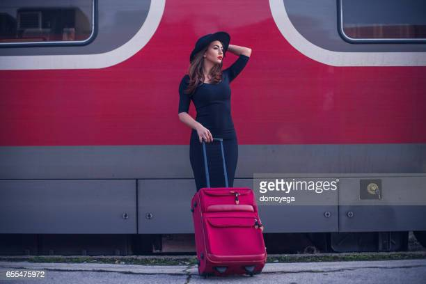 Sensual woman with a hat waiting the train