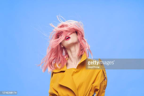 sensual woman with bright dyed hair has fun - hairstyle stock pictures, royalty-free photos & images