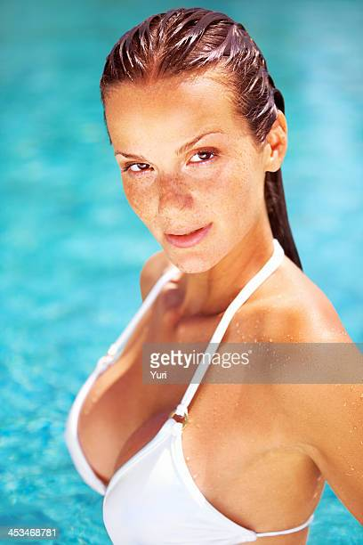 Sensual young woman in the pool