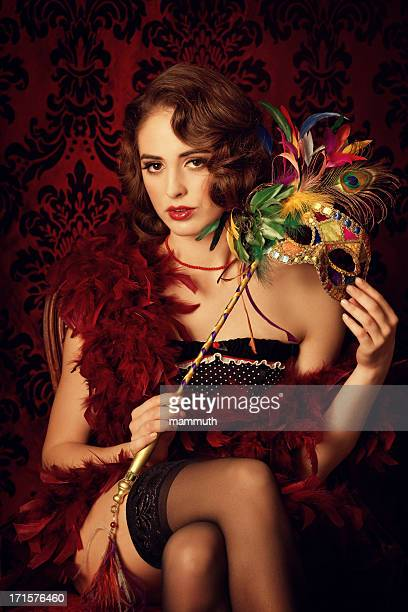 Sensual young woman with venetian mask
