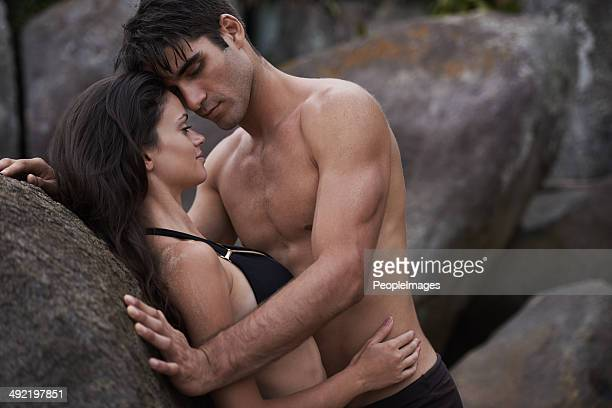 sensuality on the rocks - heterosexual couple photos stock photos and pictures