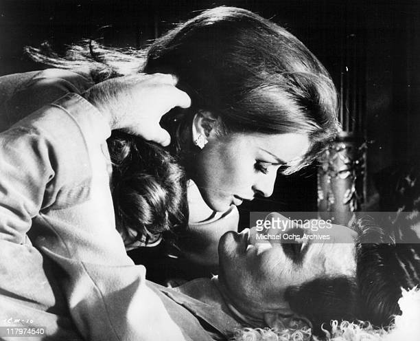 Senta Berger about to kiss Louis Jourdan in a scene from the film 'To Commit a Murder' 1967