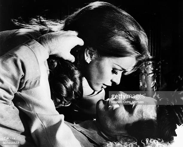 Senta Berger and Louis Jourdan get close in a scene from the movie To Commit a Murder circa 1967