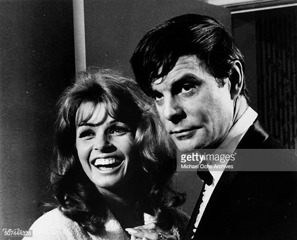 Senta Berger and Louis Jourdan look on in a scene from the movie To Commit a Murder circa 1967