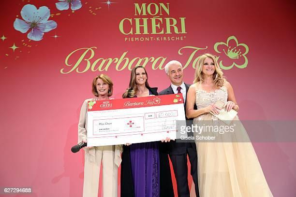 Senta Berger Hilary Swank Carlo Vassallo Director Ferrero Germany and Frauke Ludowig with check during the Mon Cheri Barbara Tag 2016 at Postpalast...