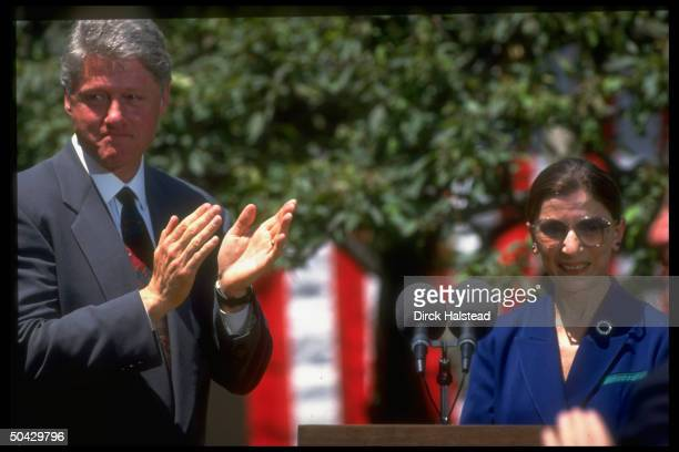 Sentimental Pres Bill Clinton applauding Judge Ruth Bader Ginsburg after Supreme Court nominee's moving acceptance speech in WH Rose Garden