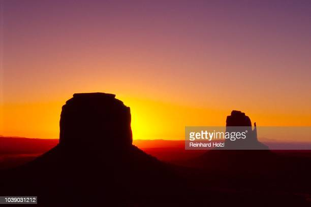 Sentinal Mesa (left) and the Mittens Butte (right), sunrise over Monument Valley, Navajo Tribal Park, Arizona, USA