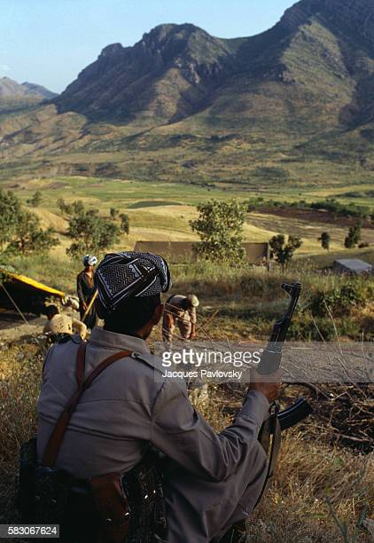 A sentinel of the Iranian Democratic Party of Kurdistan watches the valley that leads to a rebel camp