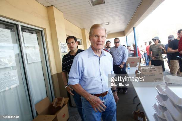 Sentors Bill Nelson right and Marco Rubio tour a Goodwill location where residents are being fed in the wake of Hurricane Irma on September 13 2017...