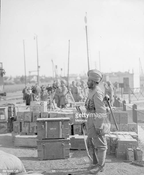 Sentry from the 3rd Lahore Indian Division seen here guarding ammunition boxes at their camp outside Orleans France Circa October 1914