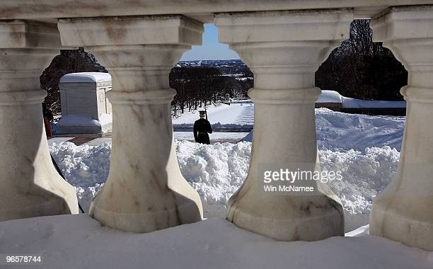 A sentry from the Old Guard stands his post at the Tomb of the Unknown Soldier amid newly fallen snow at Arlington National Cemetery February 11 2010...