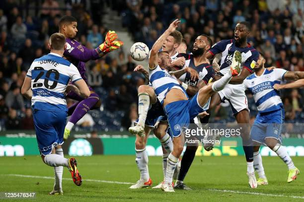 Seny Dieng of Queens Park Rangers gathers the ball from a Semi Ajayi of West Bromwich Albion header during the Sky Bet Championship match between...