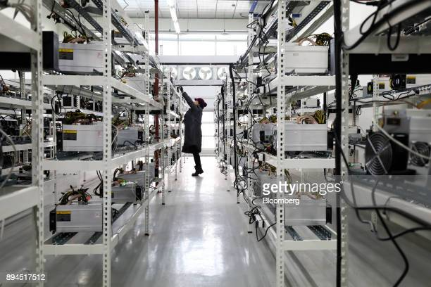 Seo Heejin inspects applicationspecific integrated circuit devices and power units manufactured by Bitmain Technologies Inc at her cryptocurrency...