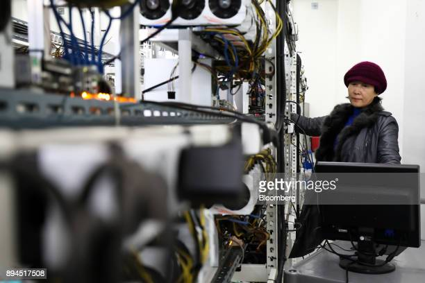 Seo Heejin inspects computer equipment at her cryptocurrency mining facility in Incheon South Korea on Friday Dec 15 2017 Hedge funds are pulling out...