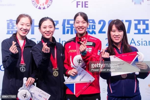 Seo Jiyeon and Kim Jiyeon of South Korea Misaki Emura of Japan and Yu Xinting of China pose for photos with their medals during the Asian Fencing...