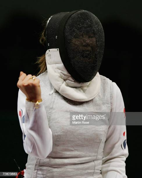 Seo Mi Jung of Republic of Korea celebrates the victory over China in the Women's Team Foil Gold Medal match during the 15th Asian Games Doha 2006 at...