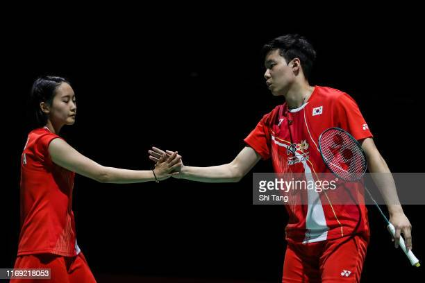 Seo Seung Jae and Chae Yujung of Korea react in the Mixed Doubles second round match against Wang ChiLin and Cheng Chi Ya of Chinese Taipei during...