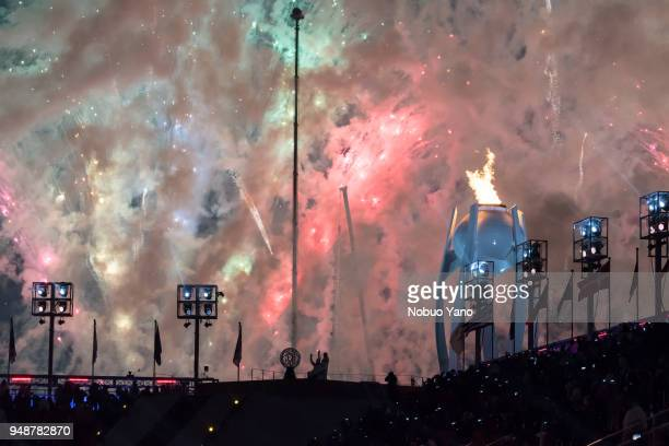 Seo Soonseok and Kim in silhouette with the Paralympic flame cauldron and fireworks during the opening ceremony of the PyeongChang 2018 Paralympic...