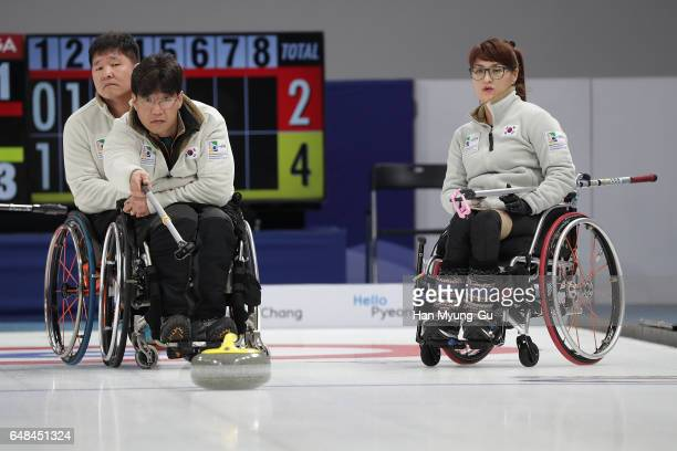 Seo SoonSeok from South Korea delivers a stone during the World Wheelchair Curling Championship 2017 test event for PyeongChang 2018 Winter Olympic...