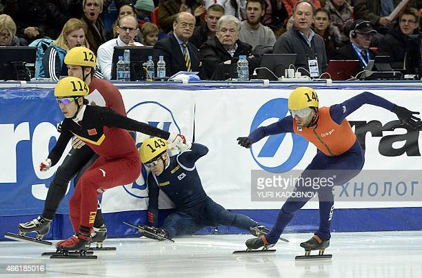 Seo Yi Ra of South Korea falls down as Shi Jingnan of China Viktor Knoch of Hungary and Daan Breeuwsma of the Netherlands continue in the men's 1500m...