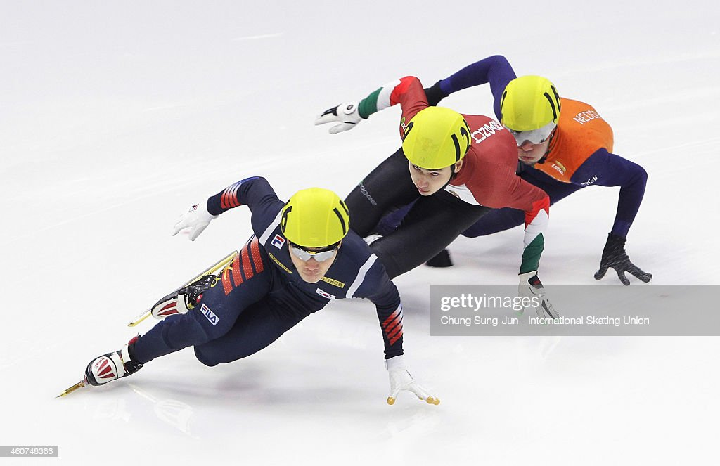 Seo Yi-Ra of South Korea, Liu Shaoang of Hungary, and Sjinkie Knegt of Netherlands compete in the Men 500M Semifinals during the ISU World Cup Short Track Speed Skating 2014/15 - Seoul at Mokdong Ice Rink on December 21, 2014 in Seoul, South Korea.