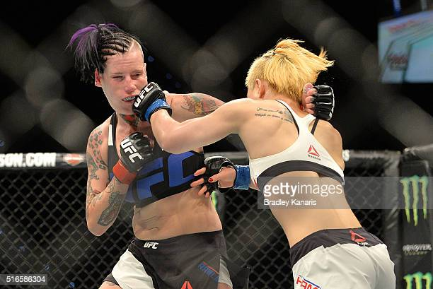 Seohee Ham lands a punch on Bec Rawlings during their UFC Strawweight bout during UFC Brisbane on March 20 2016 in Brisbane Australia
