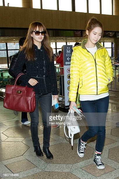 Seohyun and Yoona of South Korean girl group Girls' Generation are seen at Gimpo International Airport on February 4 2013 in Seoul South Korea