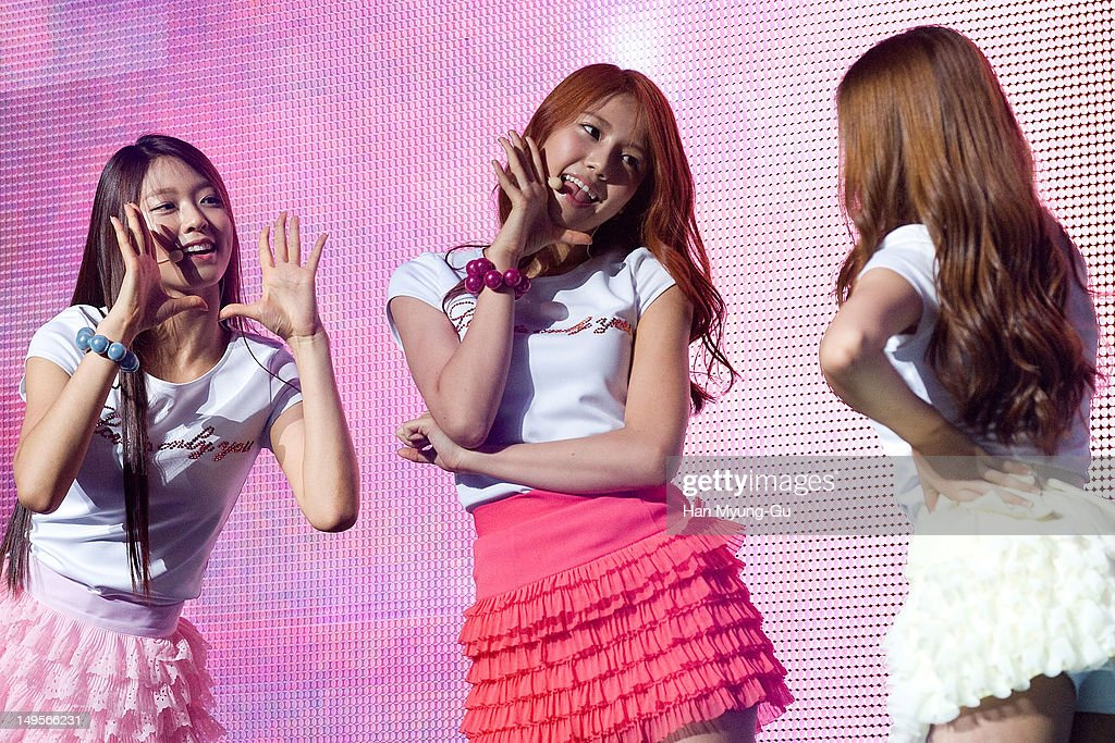 Seolhyeon and Hyejeong of South Korean girl group AOA (Ace of Angels) perform on stage during the opening of his 1st single album showcase named 'Angels' Story' on July 30, 2012 in Seoul, South Korea.