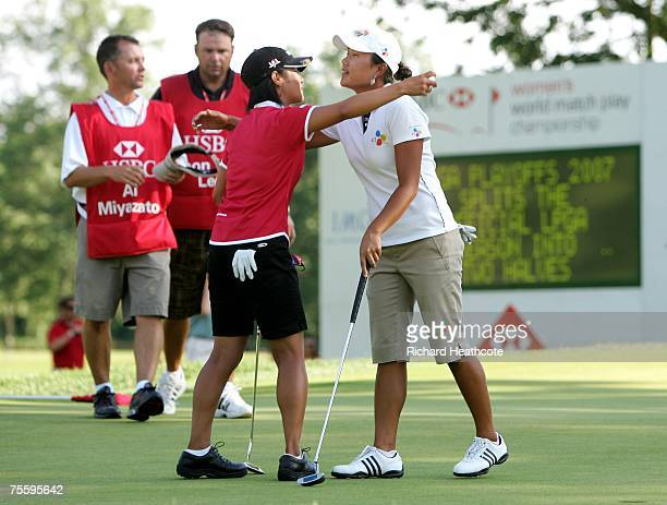 Seon Hwa Lee of South Korea is congratulated by Ai Miyazato of Japan as she wins the final of the HSBC Women's World Match Play Championship at...
