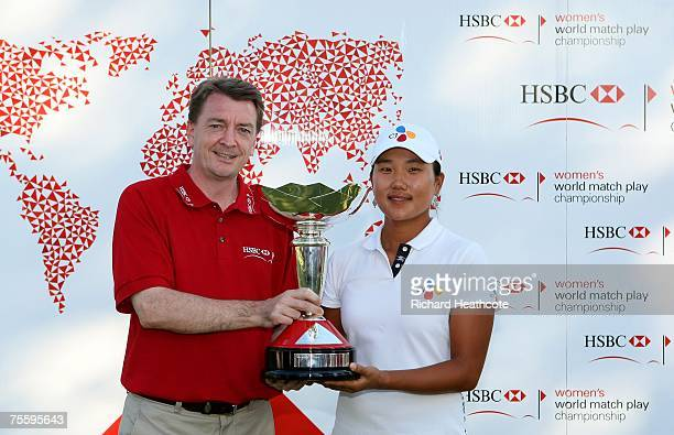 Seon Hwa Lee of South Korea recieves the trophy from Paul Lawrence President and CEO of HSBC Bank USA after winning the final of the HSBC Women's...