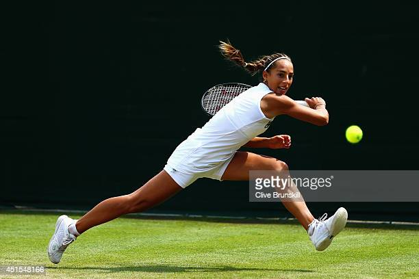 Seone Mendez of Australia during her Girls' Singles first round match against Holly Hutchinson of Great Britain on day eight of the Wimbledon Lawn...