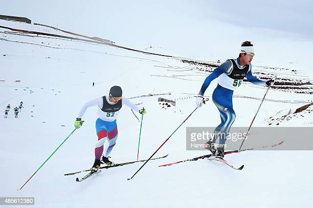 Seong-Beom Park of Korea and Jun-Ho Hwang of Korea compete in the FIS Cross-Country Skiing ANC Mass Start Classic Mens race during the Winter Games...
