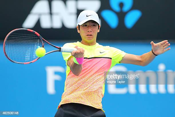 Seongchan Hong of Korea plays a shot in his semifinal match against Akira Santillan of Australia during the Australian Open 2015 Junior Championships...